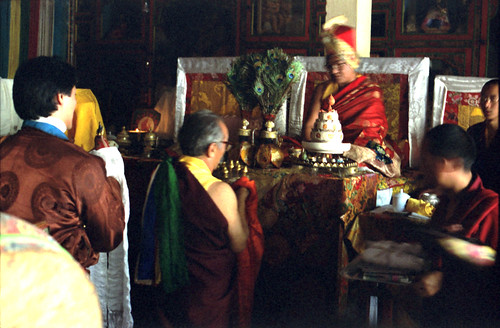 His Holiness Dagchen Sakya Rinpoche offering a mandala of the universe to His Holiness Sakya Trizin on his throne wearing the Sashu hat, in Rajpur, India 1993 by Wonderlane