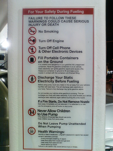 Warning plaque at petrol pump
