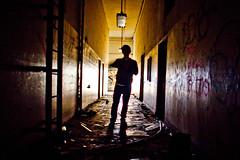 Behind the Third Door (Thomas Hawk) Tags: california usa abandoned silhouette america graffiti unitedstates 10 unitedstatesofamerica eastbay alameda fav10 andrewmoore fisc fleetindustrialsupplycenter