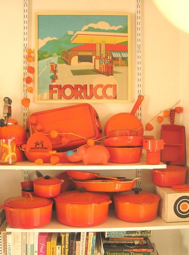 Le Creuset 'Flame' cast iron collection + vintage poster in designer Wary Meyers' kitchen