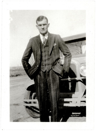man striped suit and car