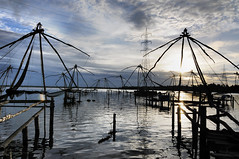 The Rising - Chinese Fishing Nets, Fort Kochi, Kerala (Anoop Negi) Tags: world wood travel girls vacation portrait people india holiday color colour men water girl festival photography for photo amazing fishing women essay media holidays power place image photos fort gorgeous delhi indian bangalore chines
