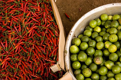 Spicy or Sour? (ethan.crowley) Tags: red wild color green colors pepper lemon cambodia cambodian bright market lemons exotic buy peppers lime bazaar sell limes ratanakiri