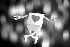 Catch me girl, coz I'm falling in love with you. (Stephen.James) Tags: blackandwhite bw motion cute love paper jump heart bokeh background romance falling jumper yoghurt