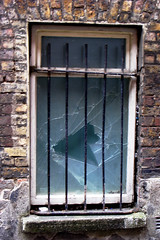 window barred (lensable) Tags: window glass bricks shattered shards barred brokenwindow lensable