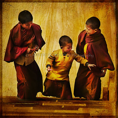 Three Golden Realms (designldg) Tags: boy red orange india kids youth children temple gold amber asia colours peace child buddhist religion atmosphere happiness buddhism panasonic human soul devotion tibetan spiritual shanti brotherhood soe yuva bihar bodhgaya  supershot abigfave indiasong overtheexcellence dmcfz18 goldstaraward
