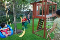 Swinging in Ajji's back yard