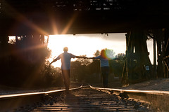 walking with Amanda on the tracks (adametrnal) Tags: sun backlight train back hands tracks flare romantic homepage hold gorillapod