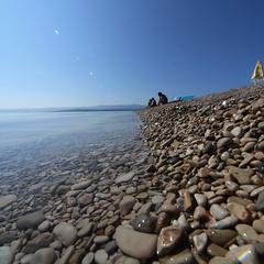 Along and towards (Lee Kindness) Tags: blue sea beach water square seaside croatia wideangle pebbles panasonic lensflare bol brac zd l10 714mm panachallenge
