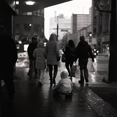 .. (Js) Tags: street winter blackandwhite bw toronto 6x6 mediumformat square pull downtown kodak pavement trix hc110 400tx sidewalk 400 pedestrians sled yashica 131 mat124g yongecollege