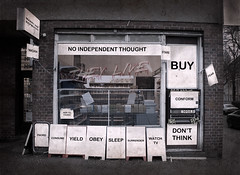 They Live (SnaPsi ) Tags: berlin sunglasses shop work germany sleep fear obey shades buy stare conform adbusters yield stationery consume sonnenbrille fnord theylive surrender ue conformity carpenter inhale urbex snapsi dontthink watchtv sieleben schreibwarenladen snapsi42 marryandreproduce noindependentthought