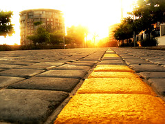 yellow brick road (daryn1979) Tags: world road sun building brick yellow stone gold glare dof bright pov path cobble rise grange mywinners flickraward goldstaraward travelandtrip