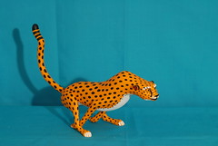 Or the Cheetah?  Oaxaca (Teyacapan) Tags: wood cats animals mexico big madera folkart arte crafts artesanias oaxaca popular carvings cheetahs mexicanas alebrijes zapotec
