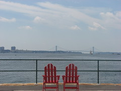 adirondack chairs overlooking bridge