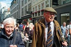 This is the modern world. (tim clements) Tags: street old people closeup copenhagen denmark couple københavn سكس østergade