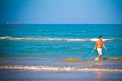 SPI Summer '09 (Mariela'sPhotography) Tags: ocean blue building green beach gulfofmexico water animal sport canon sand waves texas seagull salt skimboard xti 400d kidscanon southpadreislandspisummerrgvriograndevalley