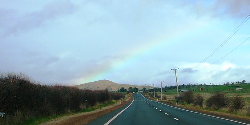 9 of 12: Rainy Landscape and Rainbow out the car window