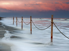 High Tide (Jesse Bissette) Tags: ocean sunset sun seascape storm beach set landscape island landscapes nc high oak nikon seascapes dunes tide north northcarolina tokina erosion carolina 1224 oakisland d300s