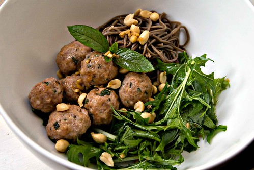 Wilted mizuna, soba noodles, banh mi style meatballs, mint, peanuts