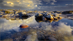 Red pebble at Traeth Ogwr (opobs) Tags: sunset sky beach water southwales wales seaside sand rocks may canon5d gitzo ogmore valeofglamorgan bridgend anglefinder ogmorebysea 2011 1740mml wetknees ogmorebeach opobs cokinxpro traethogwr michaeljstokesawpf