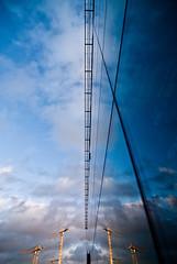 (janbat) Tags: blue sky cloud tree yellow jaune mirror nikon belgique bruxelles tokina bleu ciel reflectionsof d200 parlement miroir nuage arbre btiment f4 grue 1224 bulding jbaudebert upcoming:event=1502250