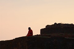 Thinker in red (timtom.ch) Tags: sunset red india man ruins sitting indian bricks pilgrim vizag visakhapatnam thotlakonda buddhistheritagesite