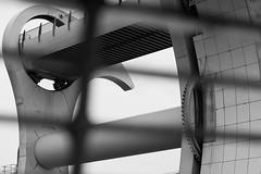 Looking through the bench at the Falkirk Wheel (Sony_A100_A700) Tags: light blackandwhite bw water monochrome wheel contrast mono scotland canal blackwhite mechanical lock gates decorative sony grain tourist shade locks leisure alpha noise 700 2009 tone functional attraction falkirk falkirkwheel a700 sonyalpha sonyalpha700 minoltaaf3570mmf3545