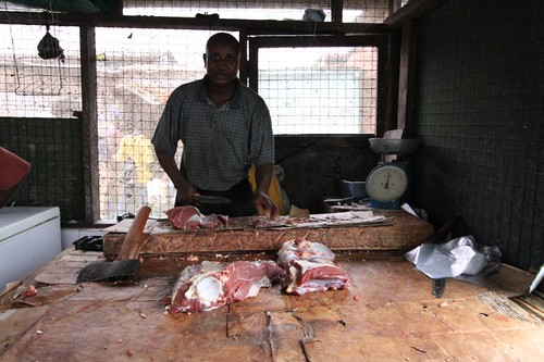 The Butcher cutting our meat...