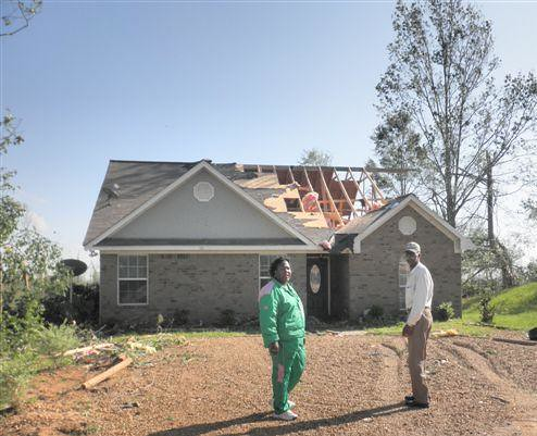 State Director Trina George and Yazoo City Mayor Mac Arthur Straughter inspect damages on afternoon after the mile-wide tornado went through Yazoo City.