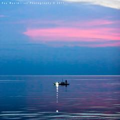 a zen way of life... (Rex Maximilian) Tags: ocean sunset sea people lamp evening boat twilight fishermen philippines larena outrigger siquijor visayanislands guiwanonspring barangayluyang visayaslight