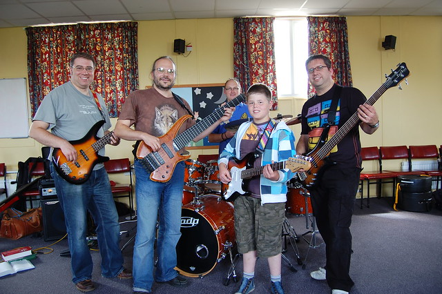 Three bassists, a guitarist and a drummer