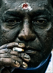 Stranger Number One. (Yug_and_her) Tags: life people man male texture face temple adult skin cigarette indian touch fingers stranger smoking nails human malaysia aged kualalumpur smoker visitor wrinkles batucaves pilgrim tilak vibudhi