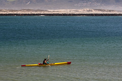 Lone Mark 1 kayaker (surf ski), near Morro Roc...