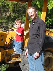 Gavin and Grandpa with a tractor