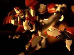 Frontal Assault (erndb) Tags: anime night japanese robot bokeh kaboom attack manga olympus queens figure zuiko mecha redandwhite 25mm fullmetalpanic e420 revoltech dbphotography arx8 laevatein frontalassault