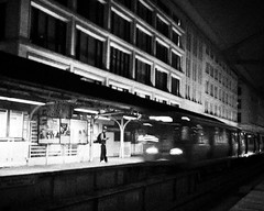 Orange Line (carlina999) Tags: urban bw chicago night train subway blackwhite waiting noir alone cta metro action platform el madison commute l ltrain elevated eltrain greenline brownline elevatedtrain orangeline chicagotransitauthority greenlimousine