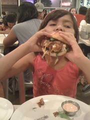 Kids first time eating burgers at the counter