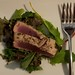 Pan-seared tuna on a bed of lettuce