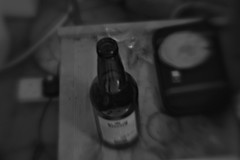 Beer bottle (ludwig van standard lamp) Tags: bw beer lensbaby bottle creativecommons selectivefocus
