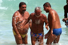 Men having fun at Copacabana beach (Ricardo Carreon) Tags: brazil 3 men praia beach water rio brasil riodejaneiro three agua rj joy wave playa copacabana explore tres alegria splash swimsuit ola plague hombres homens onda explore26january2009
