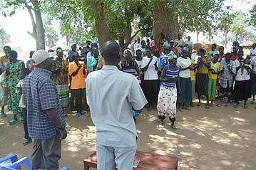 UNHCR News Story: Sudanese local officials meet refugees in Uganda; urge them to return home