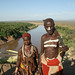 Tribal views: couple in Karo village overlooking the Omo River