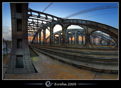 Railway bridge @ Mechelen, Belgium :: Fisheye :: HDR (Erroba) Tags: bridge sunset electric train photoshop canon rebel grafitti belgium belgique tripod belgi sigma railway fisheye wires tips remote e
