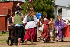 You know, if the tails those belly dancers were wearing actually wagged, our friend the hippie pirate wouldn't even need that fan.  I know, these people have their own way of doing things... I'm just trying to help! (colorblindPICASO) Tags: red people pinetree walking outside daylight cosplay walk tail crowd group sunny skirt barefoot barefeet renfaire pigtails waving redshirt periodclothing historicreenactment bluefan raccoontails fourwindsrenaissancefaire whitehousetexas trouptexas 2009fourwindsfaire fanningherself