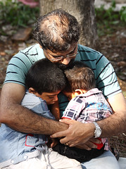 lucky boys (vbsuresh) Tags: sleeping music india man boys festival kids children daddy twins holding dad hand fireworks father watch kerala together sound elephants fest midday hold thrissurpooram 40d