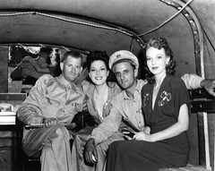 USO entertainers in the back of a military vehicle during World War II (gbaku) Tags: world pictures africa old 2 two woman history photo women war photos african military femme working picture historic photographs photograph ii american afrika historical ww femmes africain afrique africaine americain classicblackwhite afrikas