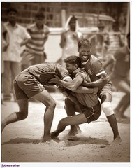 Kabaddi - Defenders Bringing Down a Raider (Sutheshnathan) Tags: india game sports village action indian south games chennai wrestle physical defender raider kabaddi kabadi sutheshnathan