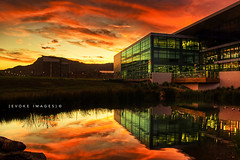 :: The Glass Building :: (evoke images) Tags: light sunset sky mountain building water glass architecture clouds reflections geotagged pond university shine australia nsw newsouthwales uni southcoast gym hdr highdynamicrange wollongong illawarra uow universityofwollongong mtkeira alemdagqu