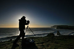 Landscape Photographer, Isle of Wight (s0ulsurfing) Tags: ocean camera blue light shadow sea people sunlight seascape man men beach water silhouette backlight composition vintage island photography bay coast focus bravo surf waves photographer bright pov candid tripod wide perspective shoreline january silhouettes wave wideangle pointofview nostalgia coastal filter cameras shore vectis isleofwight getty coastline backlit rollers grad landschaft swell isle olas oldskool 2009 largeformat humans photographing wight freshwater 10mm freshwaterbay sigma1020 nd4 fpg s0ulsurfing aplusphoto mondocafeclub