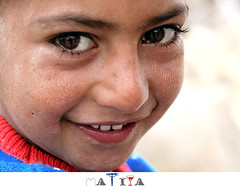 (matiya firoozfar) Tags: poverty boy portrait baby smile persian eyes child iran innocent persia  esfahan     canon400d matiya firoozfar  matiyafiroozrar